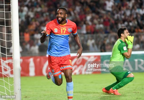 RD Congo's striker Cedric Bakambu jubilates after scoring against Tunisia during the World Cup 2018 qualifying football match between Tunisia and...