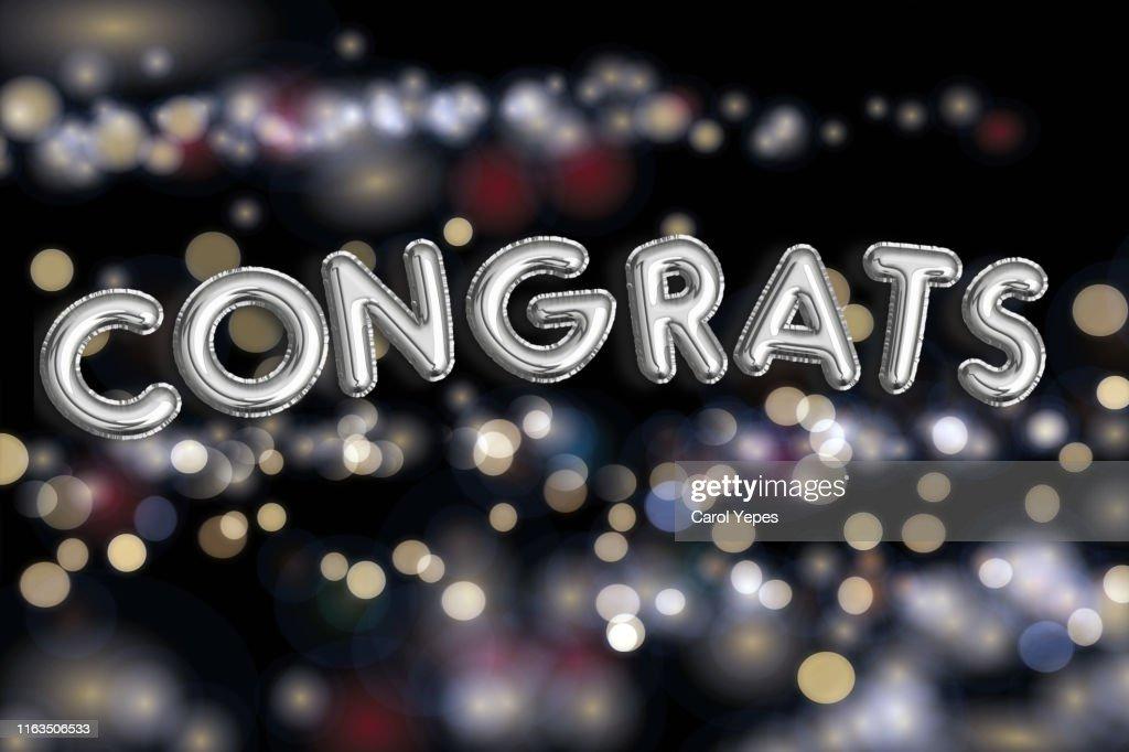 Congrats text with golden confetti : Stock Photo