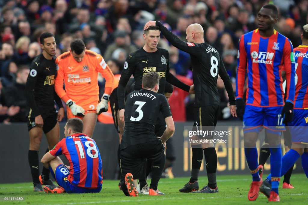 Congratulations from Jonjo Shelvey for Ciaran Clark after he makes 2 late blocks from James McArthur (L) and Christian Benteke (R) of Crystal Palace during the Premier League match between Crystal Palace and Newcastle United at Selhurst Park on February 4, 2018 in London, England.