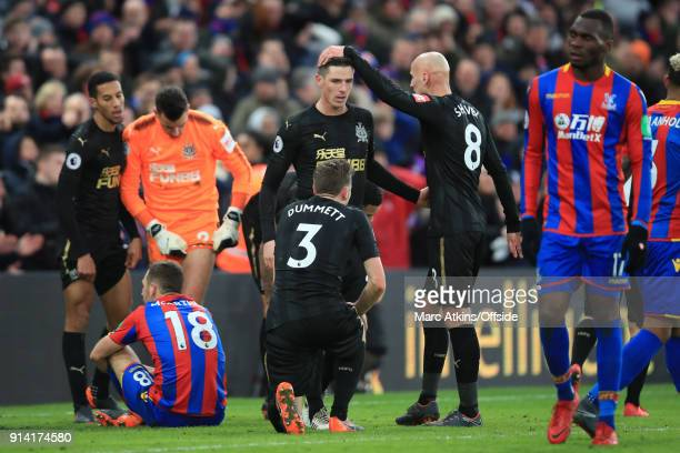Congratulations from Jonjo Shelvey for Ciaran Clark after he makes 2 late blocks from James McArthur and Christian Benteke of Crystal Palace during...