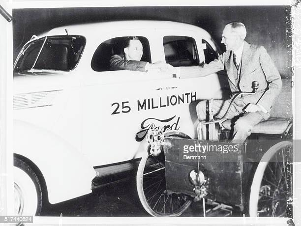 Congratulations pass from Ford to Ford as the 25 000th Ford driven off the line at the Ford factory. Edsel Ford drives the new white car while his...