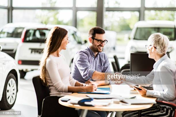 congratulations, we have a deal about buying a car! - car dealership stock pictures, royalty-free photos & images