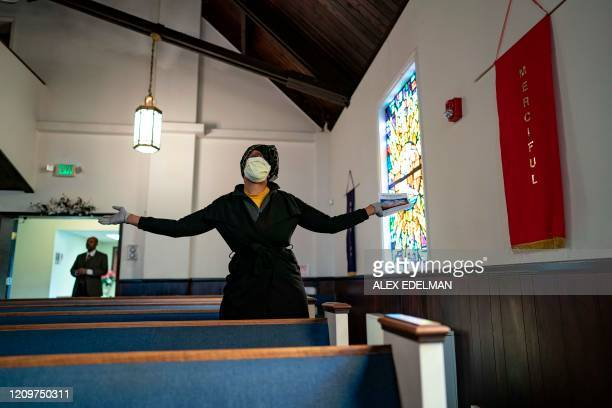 Congregants attend Sunday morning Easter services at The Friendship Baptist Church on April 12, 2020 in Baltimore, Maryland. - The church pastor,...