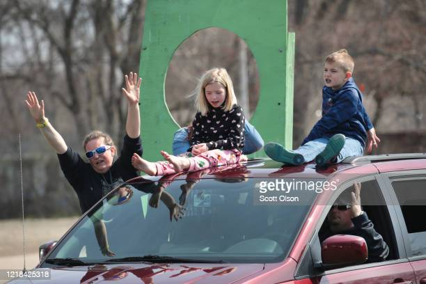 "Congregants celebrate Easter during a ""drive-up"" church service at the Family Worship Center on April 12, 2020 in Beloit, Wisconsin. Wisconsin Gov...."