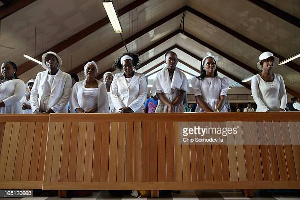 Congregants pray during Easter services at Regina Mundi Catholic Church in the Soweto area March 31 2013 in Johannesburg South Africa A central...