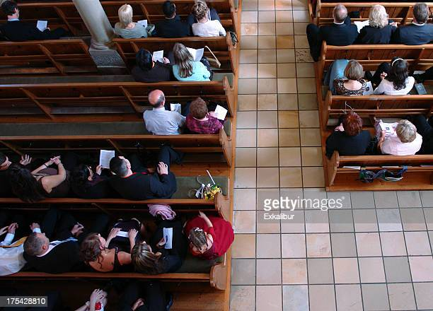 congregation at church praying - church stock pictures, royalty-free photos & images