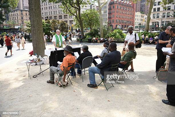 Congregation attends outdoor mass in Madison Square Park Father Seamus Campbell of Madison Square Park Congregation of Ecclesia Ministries of New...