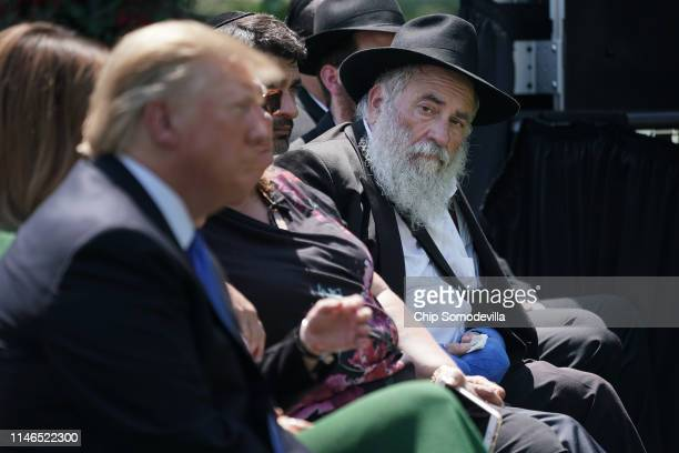Congregation Chabad Rabbi Yisroel Goldstein of Poway California looks at US President Donald Trump during a National Day of Prayer service in the...