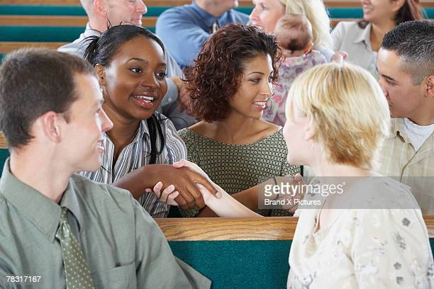 congregation greeting each other in church - church stock pictures, royalty-free photos & images