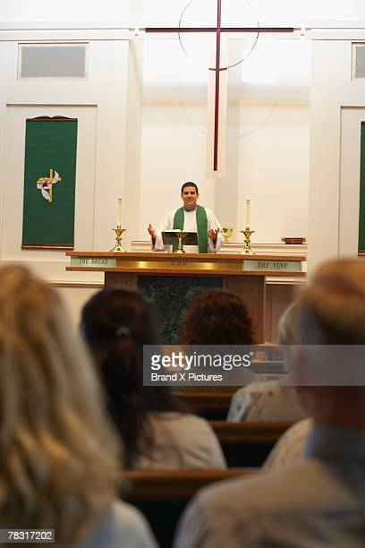 congregation listening to pastor at altar - pastor stock pictures, royalty-free photos & images