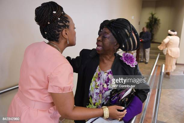 Congregation members greet each other as they arrive for Sunday Service at the Fifth Ward Church of Christ in Houston on September 3 2017 / AFP PHOTO...