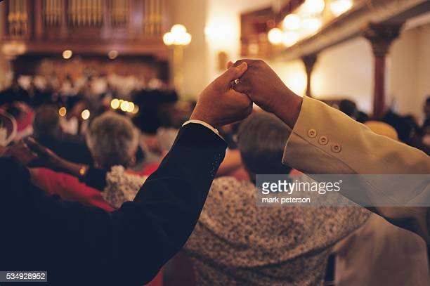 Congregation members hold hands at the Mother Bethel African Methodist Episcopal Church