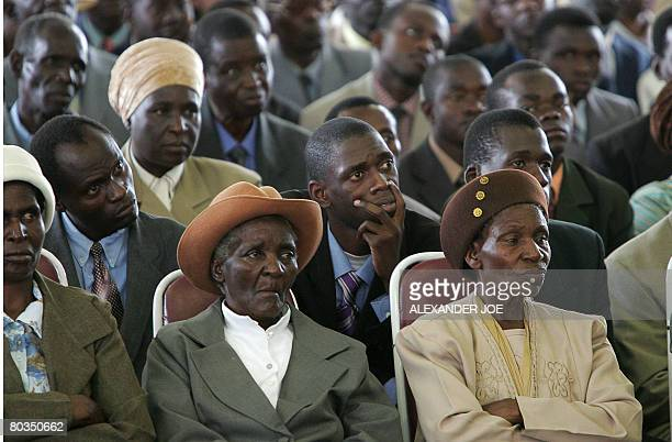 Congregation members listen to Robert Mugabe leader of Zimbabwe's ruling National Africa UnionPatriotic Front as he addresses a church service in...