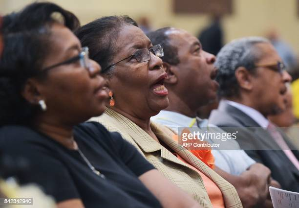 Congregation members sing a hymn during Sunday Service at the Fifth Ward Church of Christ in Houston on September 3 2017 / AFP PHOTO / MANDEL NGAN /...
