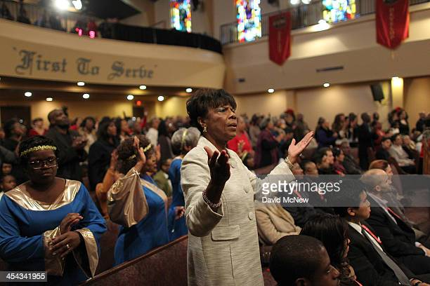 Congregation members worship at a service to honor the late South African President and antiapartheid leader Nelson Mandela at the First AME Church...