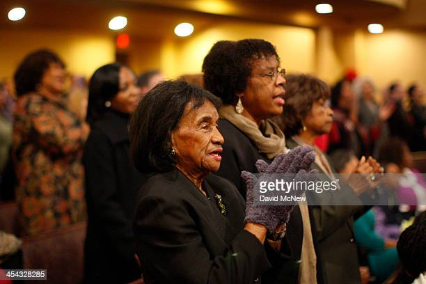Congregation members worship at service to honor the late South African President and antiapartheid leader Nelson Mandela at the First AME Church on...