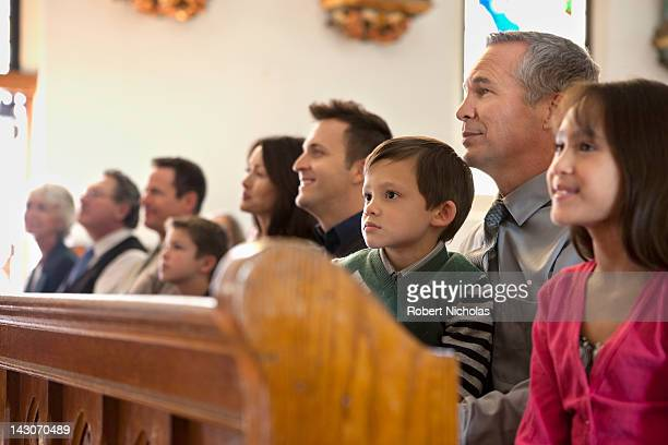 congregation sitting in church - kirche stock-fotos und bilder