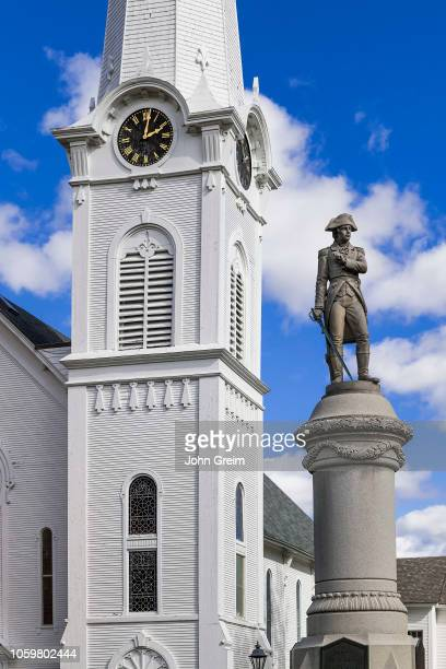 Congregational church clock tower and verterans memorial statue