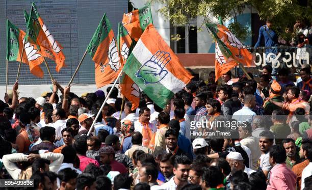 Congress and BJP supporters gather near counting center during Gujarat Assembly Elections 2017 on December 18, 2017 in Ahmedabad, India. The saffron...