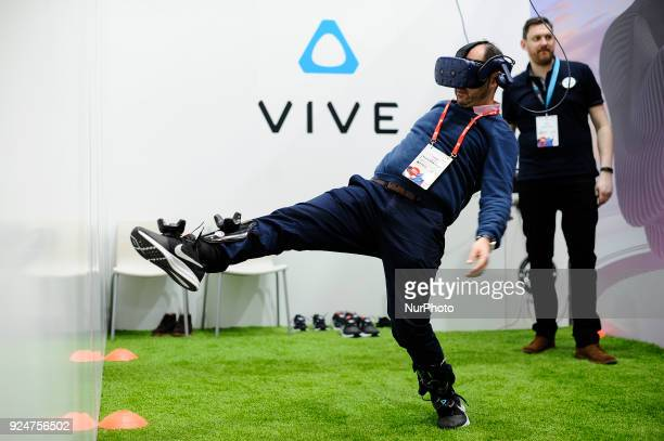 A congress attendant playing football wit the new HTC Vive Pro at the Mobile World Congress on February 26 2018 in Barcelona Spain