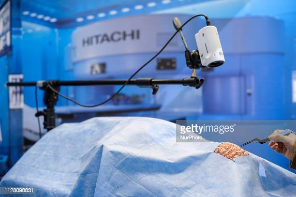 Congress attendant simulated a surgery with a 5G powered by NTT and Docomo, during the Mobile World Congress, on February 28, 2019 in Barcelona,...