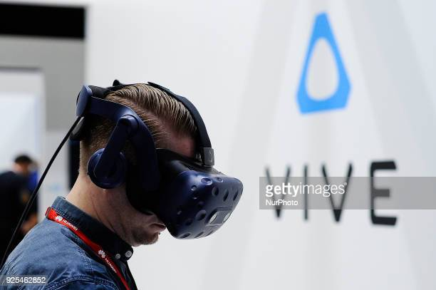 A congress attendant test the new HTC Vive Pro at HTC pavilion during the Mobile World Congress day 3 on February 28 2018 in Barcelona Spain