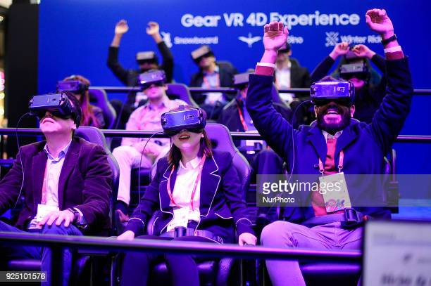 Congress attendants enjoying the Samsung Gear VR 4D experience during the Mobile World Congress Day 2 on February 27 2018 in Barcelona Spain