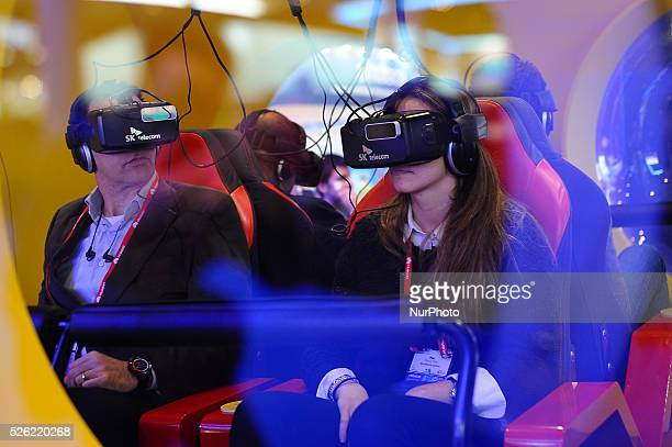 A congress attendants reacting to VK Telecom virtual 360 glasses during the last day of Mobile World Congress in Barcelona 24th of February 2016