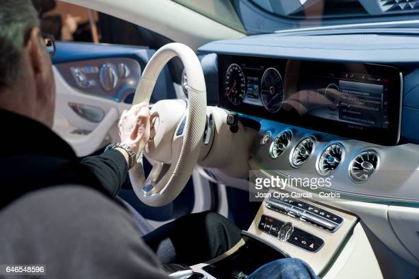 A congress attendee testing the new Mercedes Benz car screen during the Mobile World Congress on February 28 2017 in Barcelona Spain