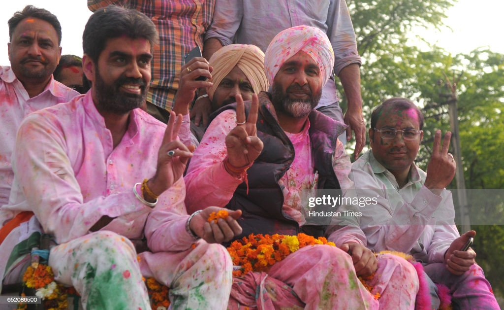 Congress candidate from Bathinda Manpreet Singh Badal celebrating with supporters after landslide victory in Punjab assembly elections on March 11...
