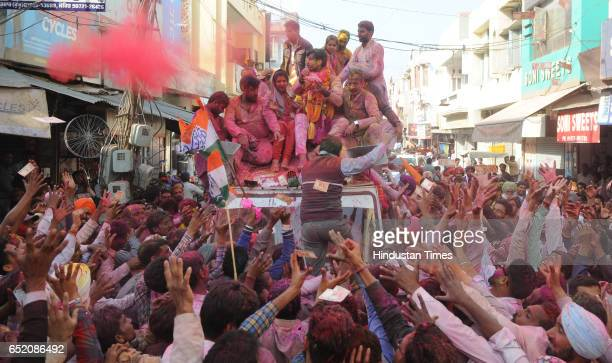 Congress Candidate from Gidderbaha Amrinder Singh Raja Warring celebrating with supporters after landslide victory in Punjab assembly elections, on...