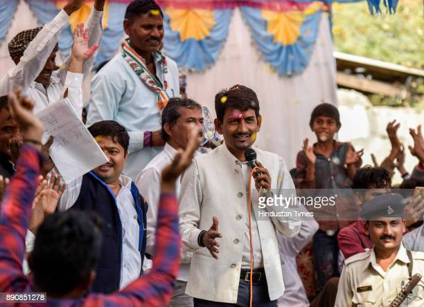 Congress candidate from Radhanpur constituency Alpesh Thakor greets people during election campaign at Radhanpur on December 11 2017 in Patan India