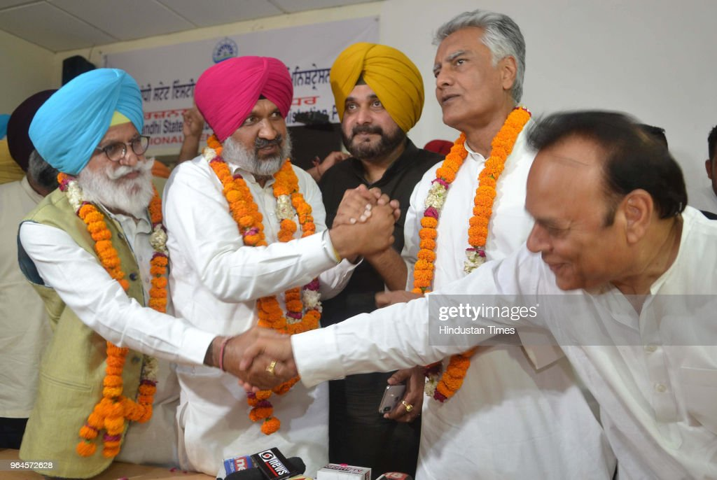 Congress candidate Hardev Singh Laddi Sherowalia shaking with PPCC president Sunil Jakhar after he won Shahkot bypoll on May 31 2018 in Jalandhar...