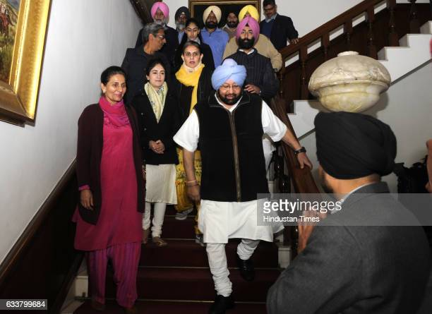 Congress Chief Ministerial candidate Captain Amarinder Singh along with his wife MLA Preneet Kaur and family members coming out of his residence to...