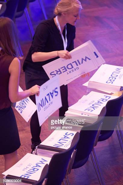 A congress employee distributes signs with the names Frauke Petry and Geert Wilders on the chairs in the room ahead of the congress of the rightwing...