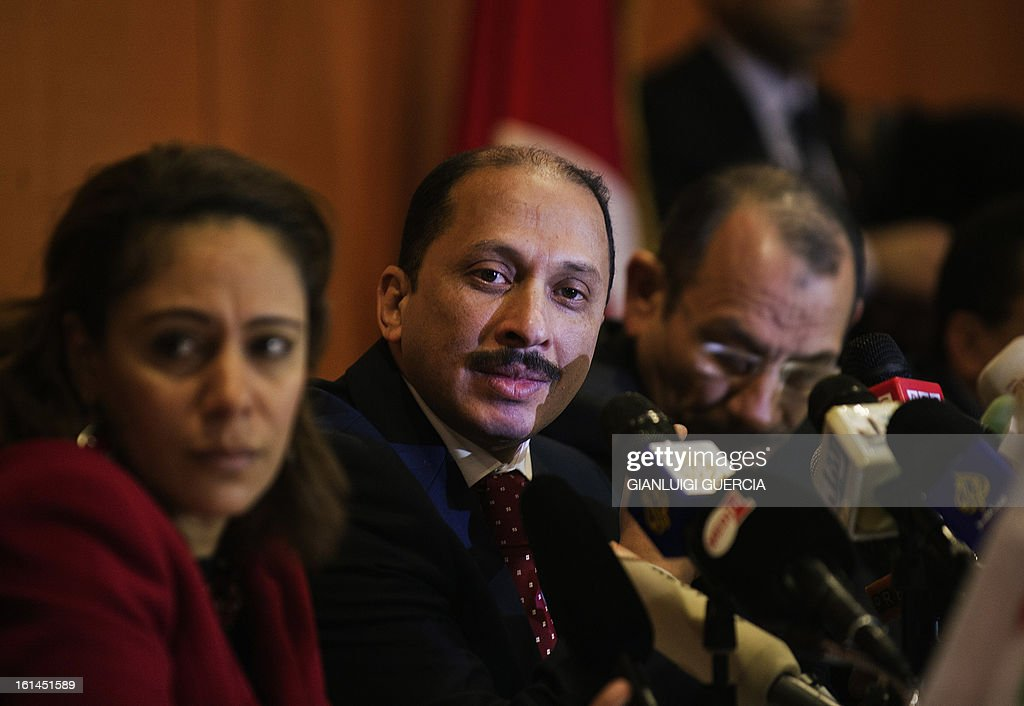 Congress for the Republic Secretary General Mohamed Abbou (C) addresses a press conference on February 11, 2013 in Tunis in which he said Tunisian President Moncef Marzouki' secular party would stay in the coalition government, pending the resignation of key ministers from the ruling Islamist party.