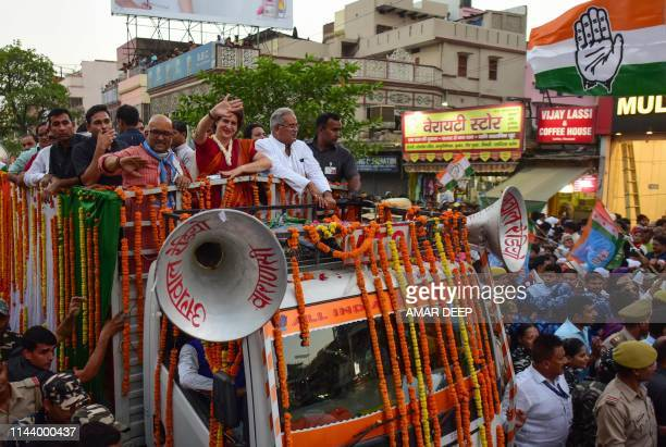 Congress general secretary Priyanka Gandhi Vadra gestures along with other party leaders during a roadshow election campaign in Varanasi on May 15...