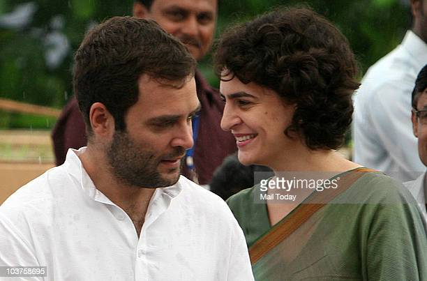 Congress General Secretary Rahul Gandhi and Priyanka Gandhi during the distribution of motorized tri-wheelers to disabled persons on the occasion of...