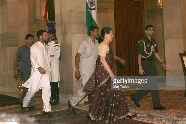 Congress General Secretary Rahul Gandhi and UPA Chairperson Sonia Gandhi arrive for the swearingin ceremony at Rashtrapati Bhavan in New Delhi on...