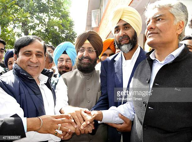 Congress Incharge for Punjab affairs Shakeel Ahamad PPCC President Pratap Singh Bajwa PPP Chief Manpreet Badal and CLP leader Sunil Jakhar showing...