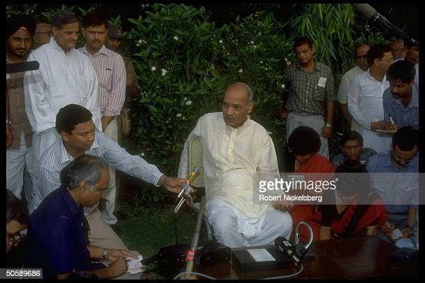 Congress interim ldr. P.V. Narasimha Rao , contender to succeed late Rajiv Gandhi as party pres. & PM cand., w. Press-types, during party mtg.