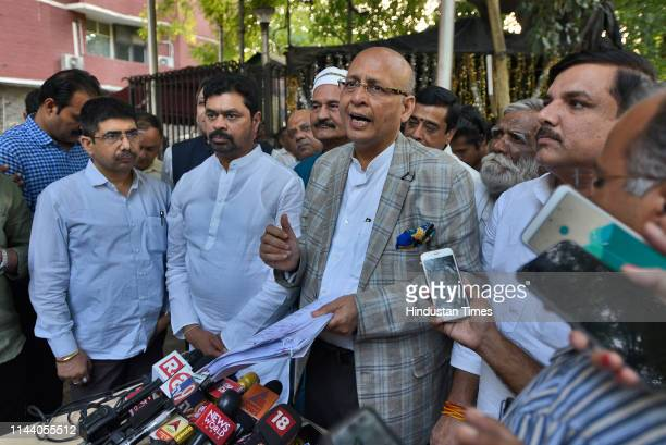 Congress leader Abhishek Manu Singhvi addresses journalists after a delegation of opposition leaders including Congress party leaders Ahmed Patel...