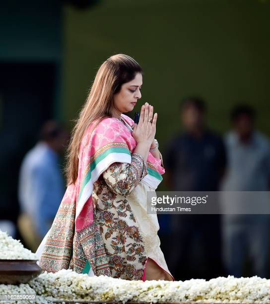 Congress leader and former film actress Nagma pays homage to former Prime Minister Rajiv Gandhi on the occasion of his 75th birth anniversary at Veer...