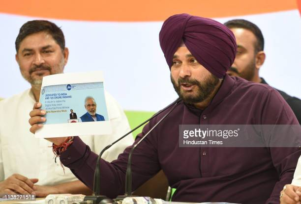 Congress leader and Punjab cabinet minister Navjot Singh Sidhu speaks to media during a press conference at AICC on April 20 2019 in New Delhi India...