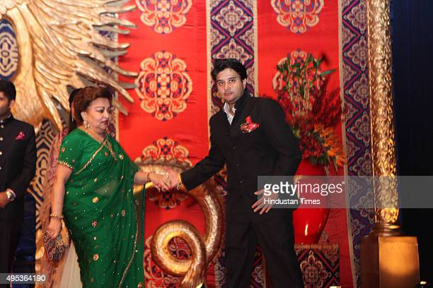 Congress leader Jyotiraditya Madhavrao Scindia with his mother Madhavi Raje Scindia during the wedding reception of MP and Congress spokesperson...