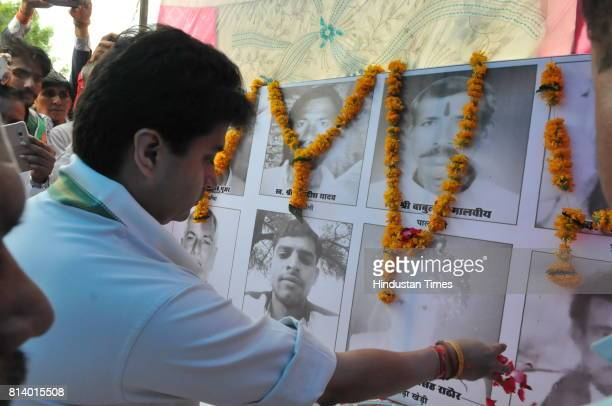 Congress leader Jyotiraditya Scindia paying respect to farmers who committed suicide at a condolence meet on July 13 2017 in Sehore India