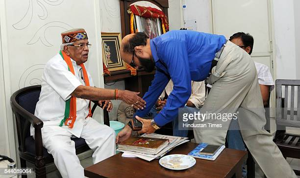 Congress leader KK Mishra taking blessings of senior BJP leader and former Home Minister Babulal Gaur on July 1 2016 in Bhopal India 86yearold...
