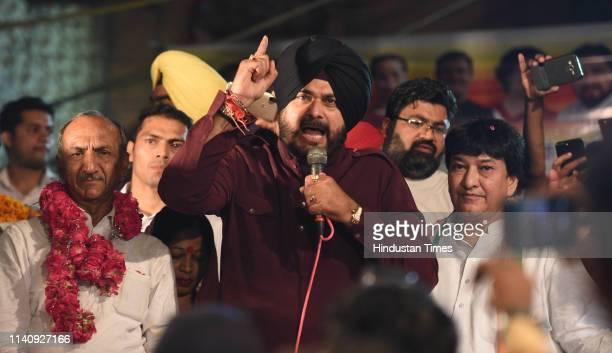 Congress leader Navjot Singh Sidhu addresses an election meeting ahead of the Lok Sabha elections at Prem Nagar Nabi Karim on May 3 2019 in New Delhi...