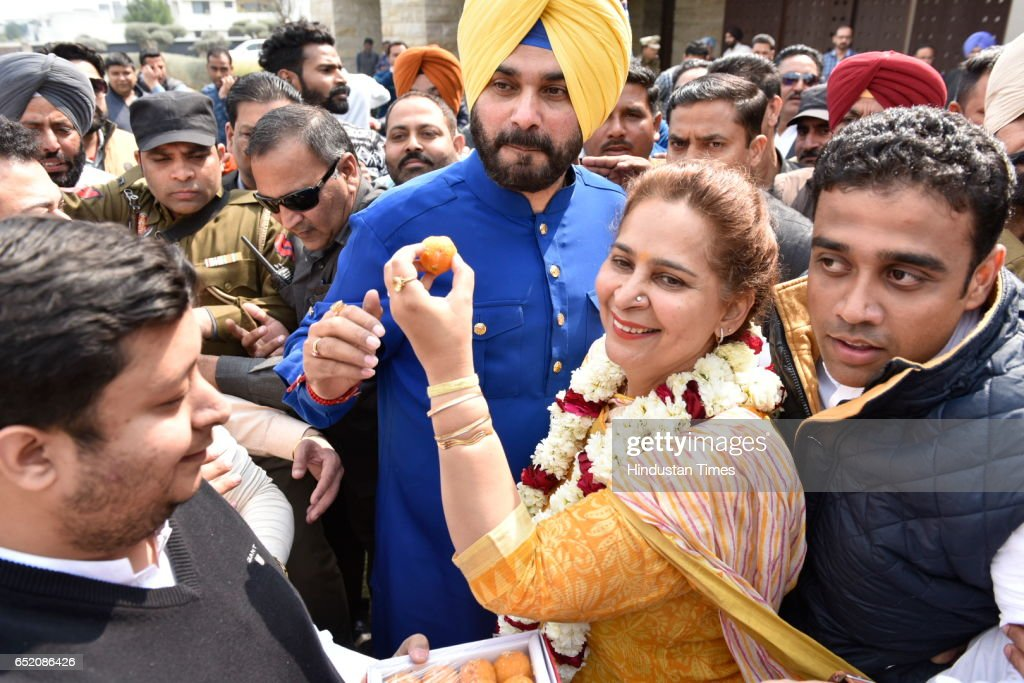 Congress leader Navjot Singh Sidhu along his wife Dr Navjot Kaur Sidhu celebrating victory on March 11 2017 in Amritsar India Sidhu said Congress has.
