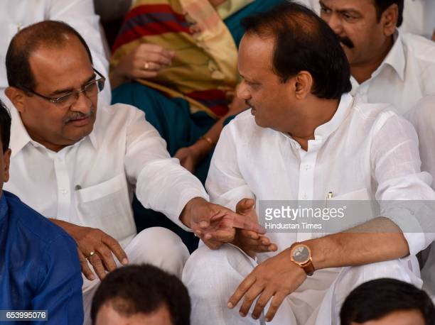 Congress leader Radhakrishna Vikhe Patil and NCP leader Ajit Pawar chats during protest against waiver for farmer loans at the Maharashtra Assembly...